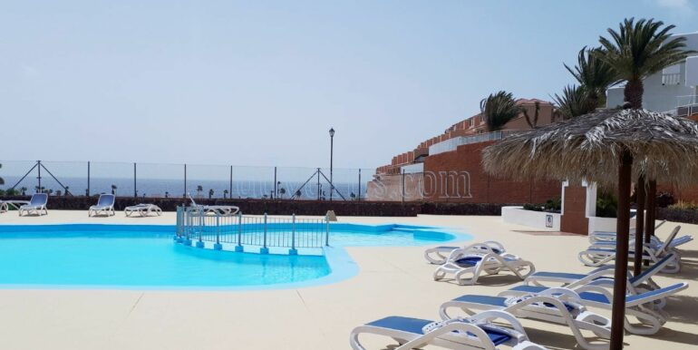 Spacious 2 bedroom apartment for sale on ground floor with 2 terraces situated on quiet, well-kept complex Sand Club with communal pool.